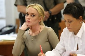Lindsay Lohan and her dad face separate charges and possible jail time!
