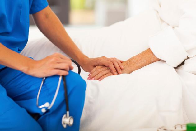 medical doctor comforting senior patient