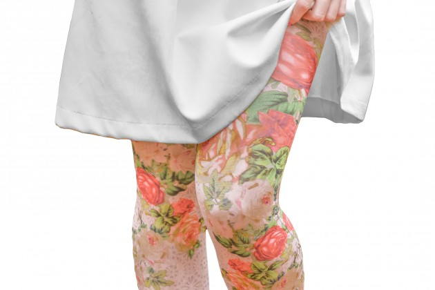 Women Legs with Printed Floral Leggings Isolated