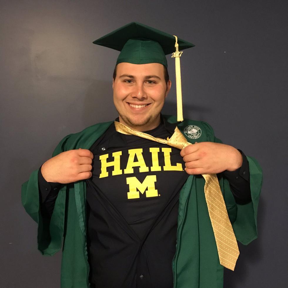 THE BLASPHEMY! MSU Graduate Reveals a Michigan Shirt Under Cap&Gown